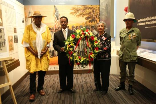 Dr. Mikael Wossen and Ms. Gail Hansberry presenting wreath accompanied with Father Melvin Deal and Sergeant Ashenafi Kebede